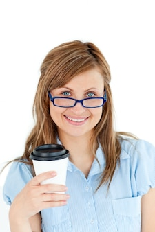 Pretty caucasian businesswoman holding a coffee wearing glasses