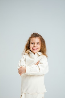 Pretty caucasian girl portrait isolated on white  wall with copyspace