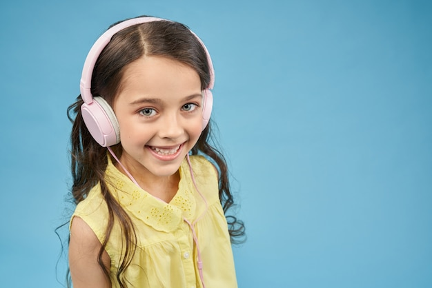 Pretty child listening music and relaxing