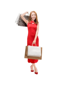 Pretty chinese woman with cheongsam dress holding shopping bags