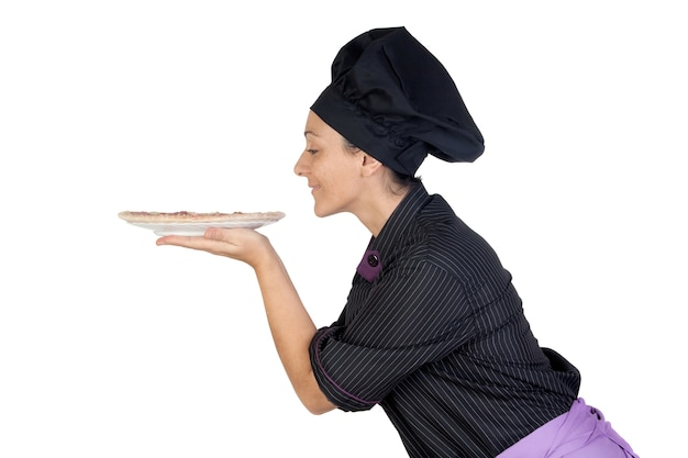 Pretty cook woman smelling ham pizza on white background