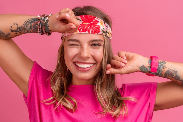 Pretty cute smiling woman in pink shirt boho hippie style accessories smiling emotional fun posing on pink