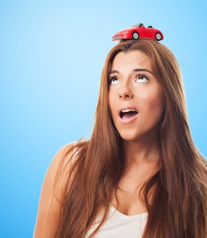 Pretty female with a little car on her head