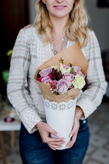 Pretty florist with bunch of flowers