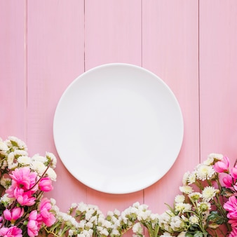 Pretty flowers near plate