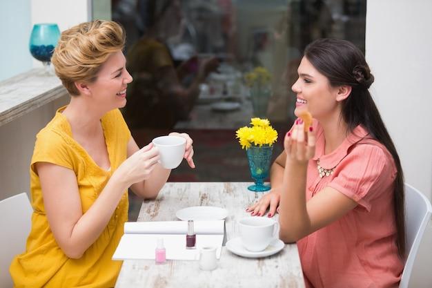 Pretty friends having a coffee