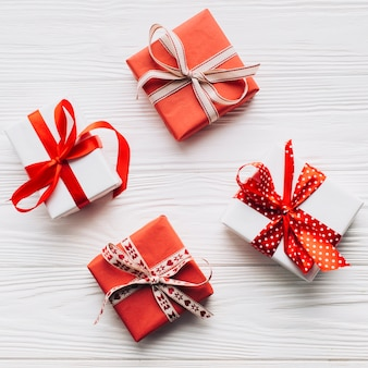 Pretty gift boxes on white background