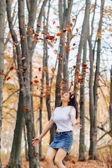 Pretty girl at autumn park