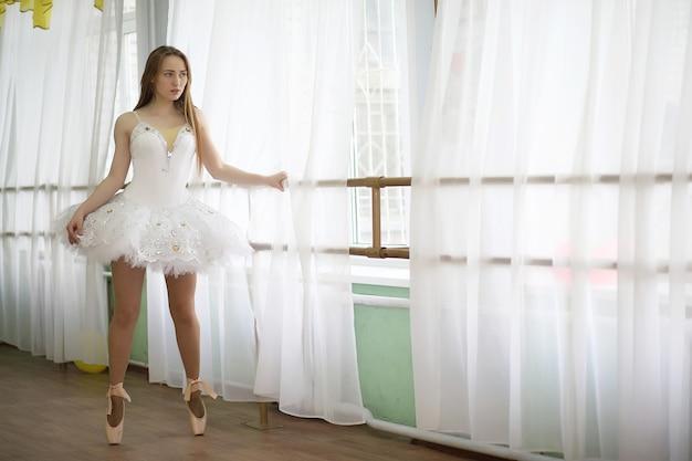 Pretty girl ballet dancer practicing indoor