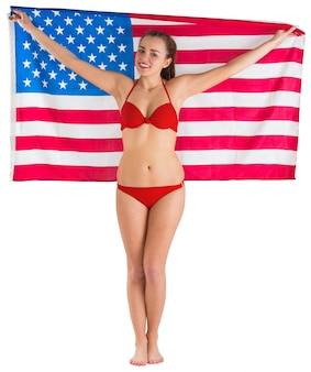 Pretty girl in bikini with american flag