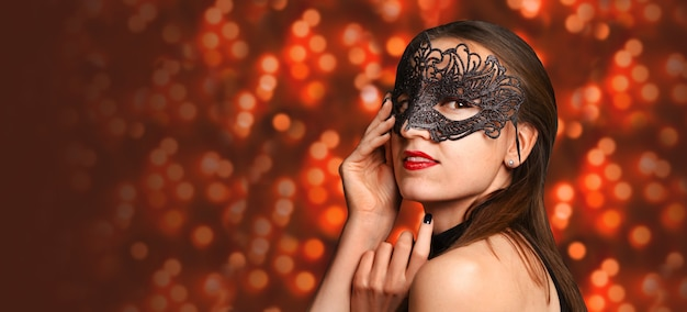 Pretty girl in black masquerade mask. carnival concepr. banner.