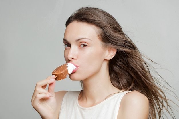 Pretty girl eating ice lolly