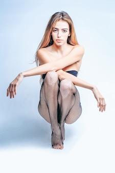 Pretty girl in fishnet tights