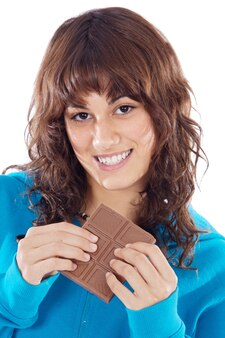 Pretty girl holding a chocolate tablet isolated in white