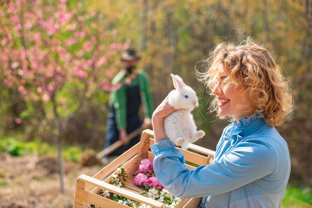 Pretty girl preparing for easter. spring. woman and rabbit.