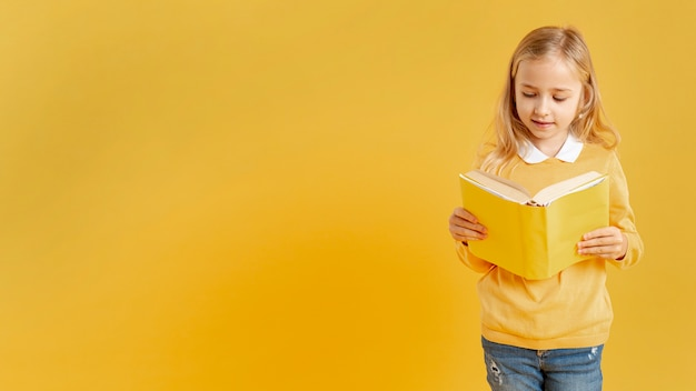 Pretty girl reading with copy-space