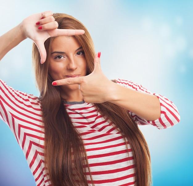 Pretty girl showing gesture like frame.