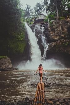 Pretty girl at tegenungan waterfall, bali