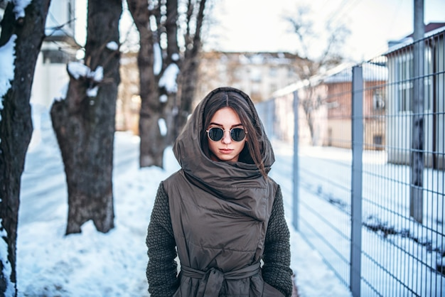 Pretty girl walking outdoor on the street, winter time.