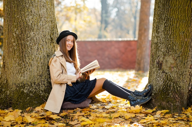 Pretty girl with a book in the forest