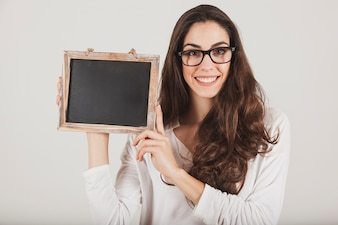 Pretty girl with glasses and slate