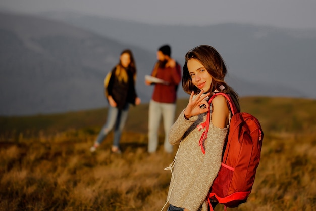Pretty girl with red backpack