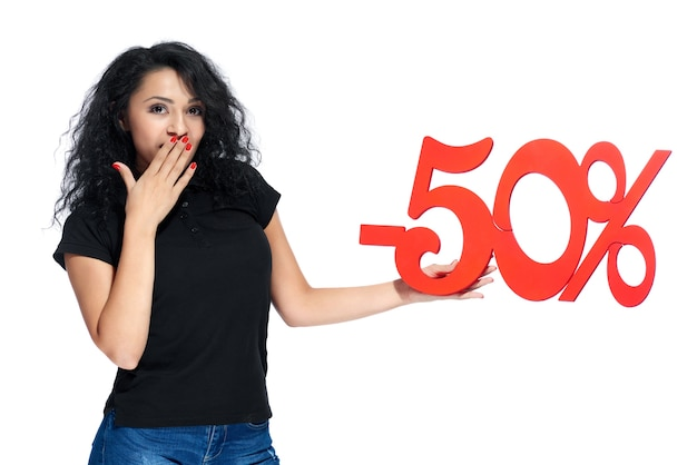 Pretty girl with a sign -50% sale on the white background