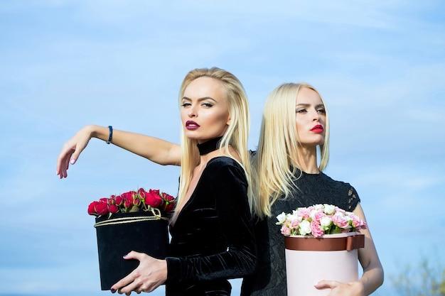 Pretty girls with flowers in box Premium Photo
