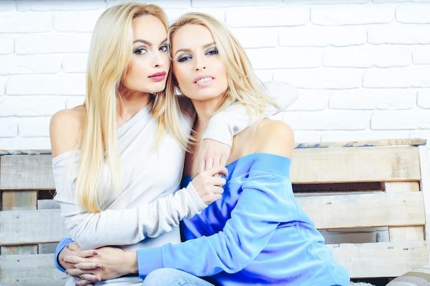 Pretty girls on wooden sofa