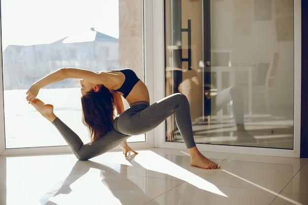 Pretty gymnast near windows