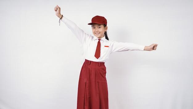 白い背景で隔離のかなり幸せな小学生の女子高生