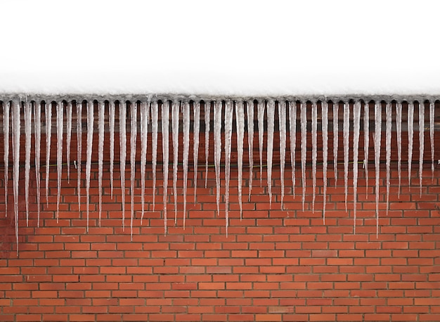 Pretty icicles brick wall background