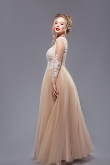 Pretty lady with red lips in elegant evening dress Premium Photo