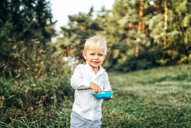 Pretty little baby boy have fun outdoor