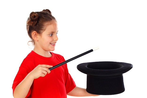 Pretty little girl doing magic with a top hat and a magic wand