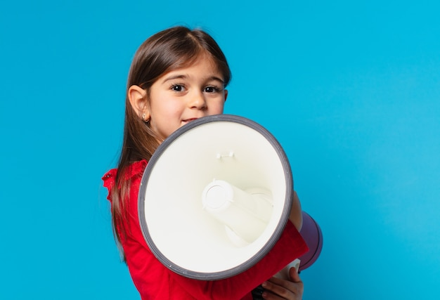Pretty little girl happy expression and holding a megaphone