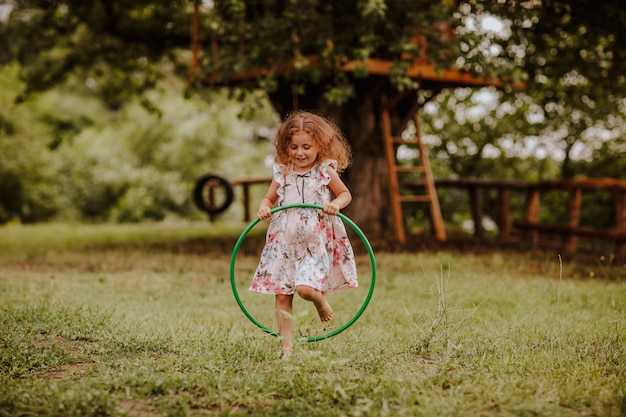 Pretty little girl with a hoop
