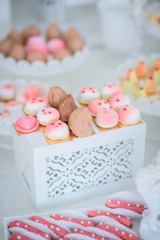 Pretty little pink and white cakes and eclairs