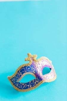 Pretty mask on blue