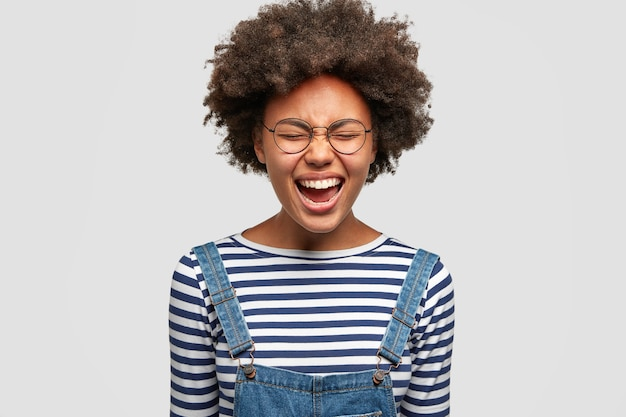 Pretty mixed race female model laughs happily