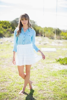 Pretty model wearing trendy clothes posing outside