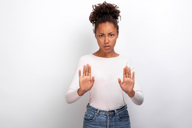 Pretty mulatto girl raised hands in s gesture