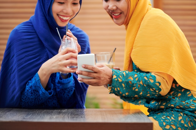 Pretty muslim women taking selfie