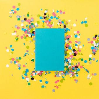 Pretty notebook for mock up on yellow background with confetti around