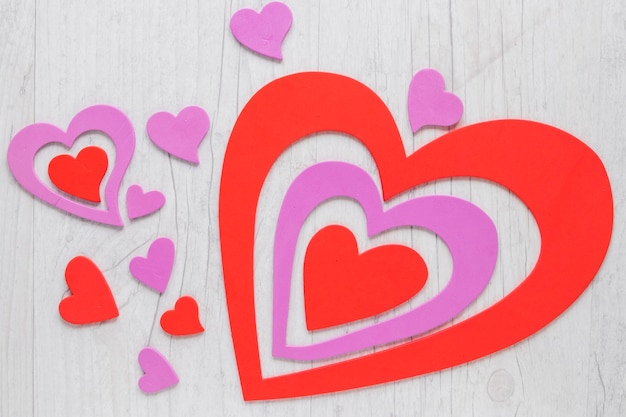 Pretty paper hearts on lumber background