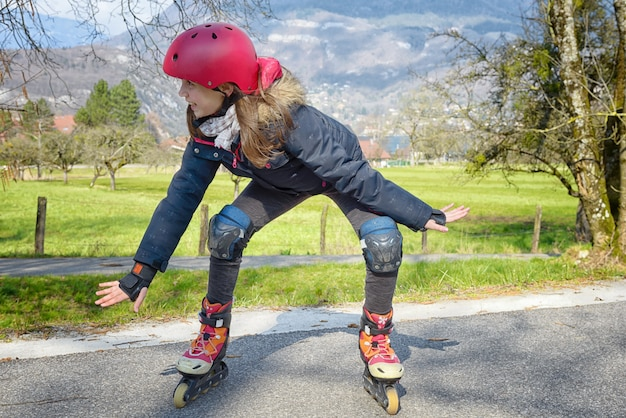 Pretty preteen woman on roller skates