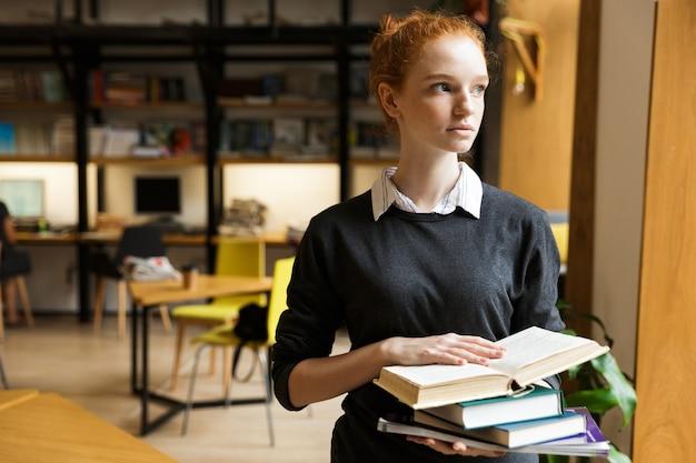 Pretty red haired teenage girl in earphones