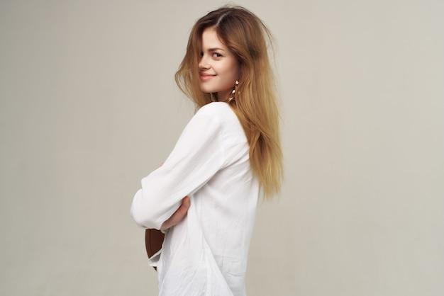 Pretty redhaired woman decoration white shirt fashion posing