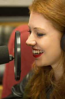 Pretty redhead student presenting a radio show