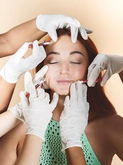 Pretty redhead woman undergoing botox treatment